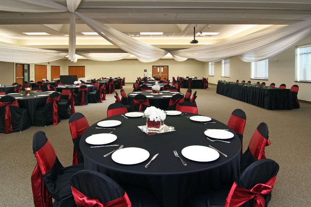 Banquet tables with place settings and table clothes
